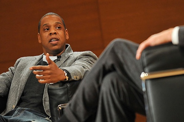 Jay-Z being interviewed about his memoir by Charlie Rose